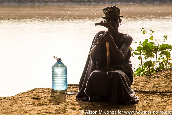 A Dassenech tribal elder on Ethiopia's Omo River, perhaps pondering the gift of water and the hours women spent collecting it for his village.