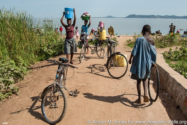Tanzania: No Water No Life Mara River Expedition, Musoma, on Lake Victoria, local beach used for washing, laundry, swimming and collection of water taken home in buckets carried on the head and on bicycles